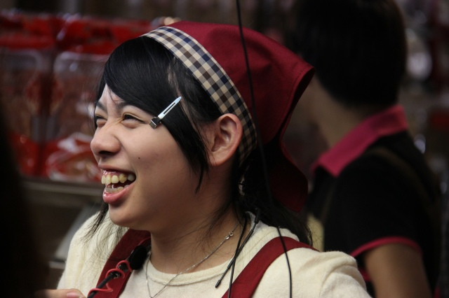 A giggling Taipei night market vendor.