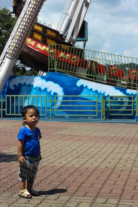The saddest (and only) boy at the amusement park.